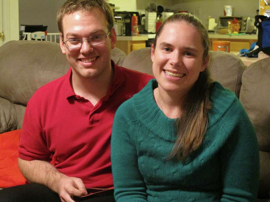 Alyssa Riggan, who was the first in the United States to successfully receive a liver from a living donor 25 years ago, poses with her husband, Benjamin, in their home Nov. 25 in Severn, Md. As Riggan marks the 25th anniversary of her successful surgery on Thursday, she says its success has enabled her to live a normal life almost completely untouched by what was an often-fatal disorder. Riggan was 21 months old when her mother, Teri Smith, donated more than a third of her liver to save her daughter from a disorder called biliary atresia. Photo: Associated Press  / AP