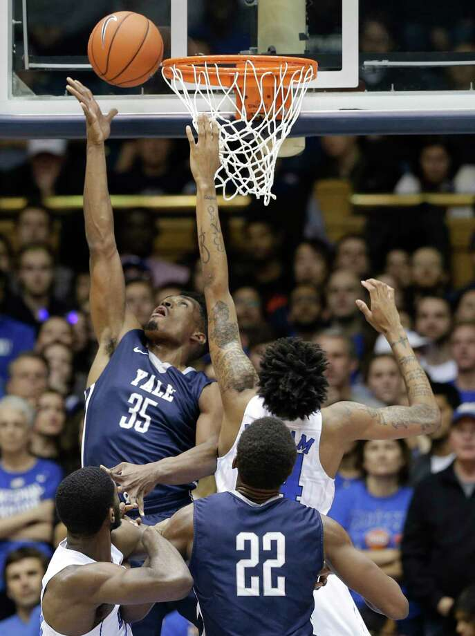 Duke's Brandon Ingram defends Yale's Brandon Sherrod (35) during the first half of the Blue Devils' 80-61 win on Wednesday. Photo: Gerry Broome — The Associated Press  / AP