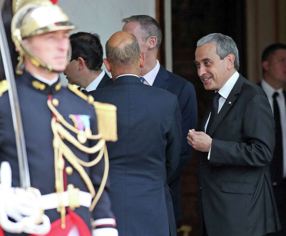 Chief of protocol at the French presidential palace, right, Laurent Stefanini, 54, confers with an unidentified person prior to the arrival of the Spainís King Felipe VI at the Elysee Palace in Paris, France, Tuesday, June 2, 2015. The French government is expecting the Vatican to decide within days whether to approve the nomination of a respected diplomat who is said to be gay as French ambassador to the Holy See. Paris is hoping that Laurent Stefanini wins approval five months after the French presidential palace submitted his nomination. (AP Photo/Remy de la Mauviniere) Photo: AP / AP