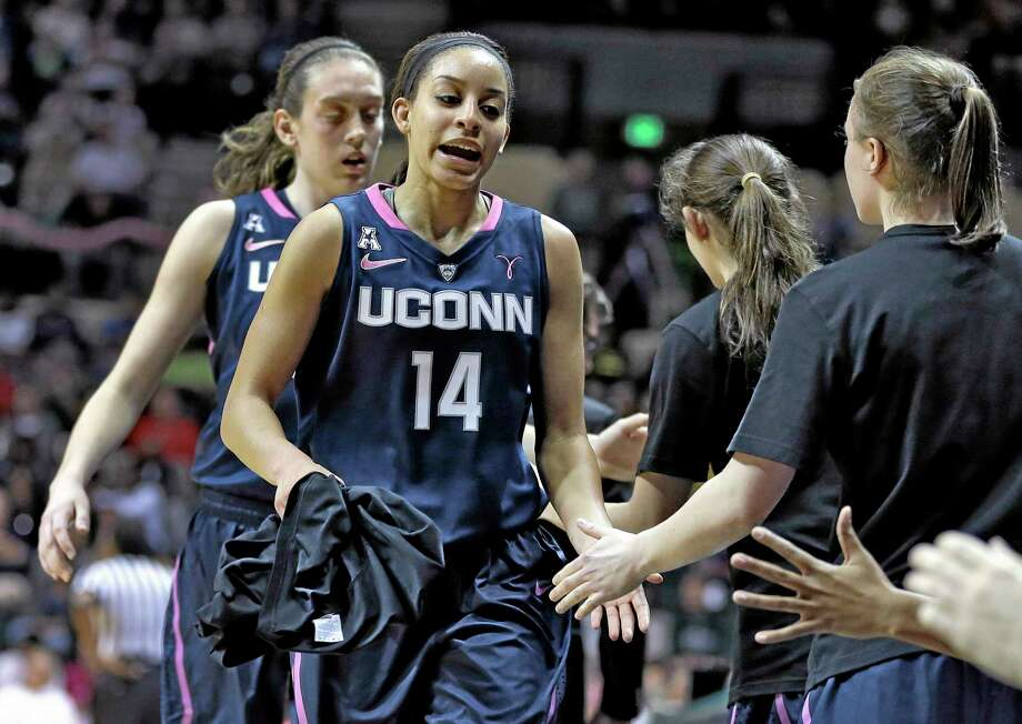 UConn guard Bria Hartley (14) shakes hands with teammates after being taken out of their game against South Florida on Sunday. Photo: Chris O'Meara — The Associated Press  / AP