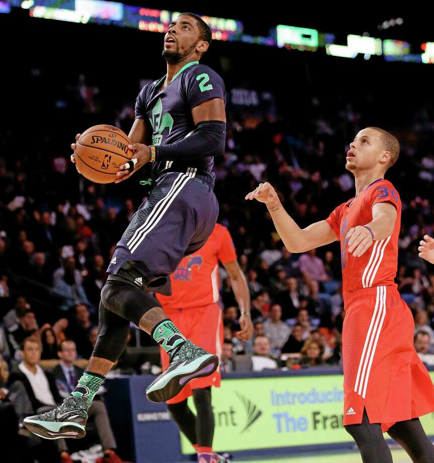 The East team's Kyrie Irving goes to the hoop during the NBA All Star game Sunday in New Orleans. Photo: Gerald Herbert — The Associated Press  / AP