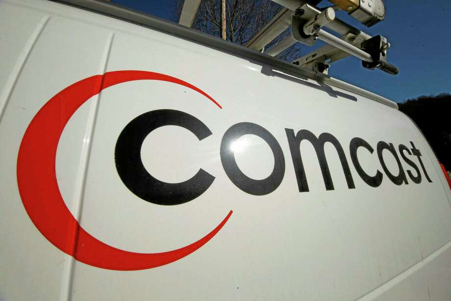 FILE - This Feb. 11, 2011 file photo shows the Comcast logo on one of the company's vehicles, in Pittsburgh. Comcast has agreed to buy Time Warner Cable for $45.2 billion in stock, or $158.82 per share, in a deal that would combine the top two cable TV companies in the nation, according to a person familiar with the matter who spoke on condition of anonymity because it had not been announced formally. An announcement is set for Thursday morning, Feb. 13, 2014, the person said. (AP Photo/Gene J. Puskar, File) Photo: AP / AP