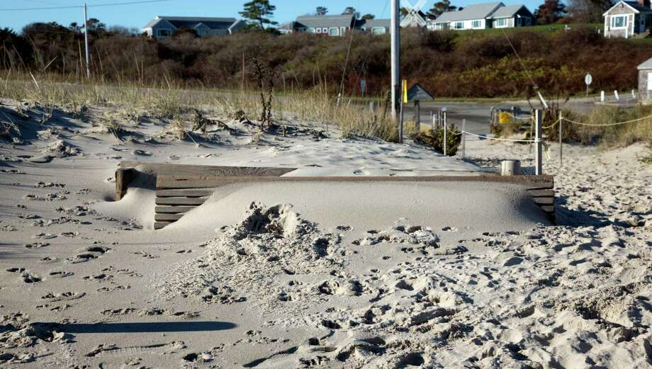 In this photo taken on Nov. 13, 2015, sand covers a bench on Nauset Beach in Orleans, Massachusetts. Delegates from more than 190 governments will meet in Paris in the next two weeks to negotiate a new deal to fight climate change. Photo: AP Photo/Virginia Mayo  / AP