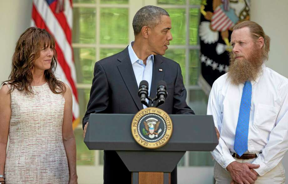 President Barack Obama looks to Bob Bergdahl as Jani Bergdahl, stands at left, during a news conference in the Rose Garden of the White House in Washington on Saturday, May 31, 2014 about the release of their son, U.S. Army Sgt. Bowe Bergdahl. Bergdahl, 28, had been held prisoner by the Taliban since June 30, 2009. He was handed over to U.S. special forces by the Taliban in exchange for the release of five Afghan detainees held by the United States. (AP Photo/Carolyn Kaster) Photo: AP / AP