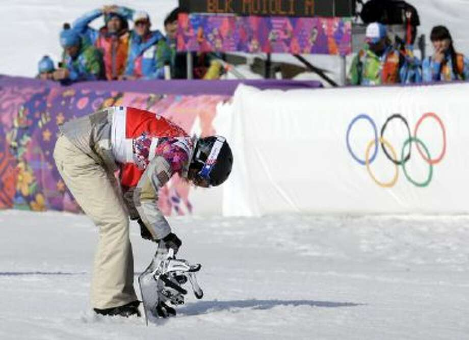Lindsey Jacobellis of the United States reacts after crashing in the second semifinal of the women's snowboard cross at the Rosa Khutor Extreme Park, at the 2014 Winter Olympics, Sunday in Krasnaya Polyana, Russia.