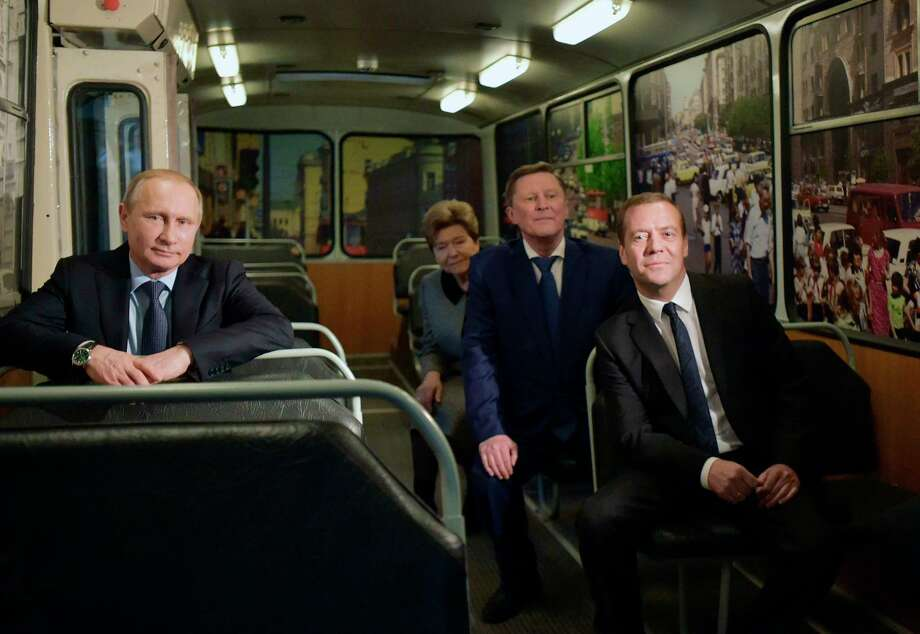 Russian President Vladimir Putin, left, Prime Minister Dmitry Medvedev, right, presidential Chief of Staff Sergei Ivanov and widow of the first Russian President Naina Yeltsin visit the Yeltsin museum which opened in Yekaterinburg, the city in the Ural mountains, Russia on Nov. 25, 2015. Photo: Alexander Astafyev/Sputnik, Government Pool Photo Via AP  / POOL SPUTNIK GOVERNMENT