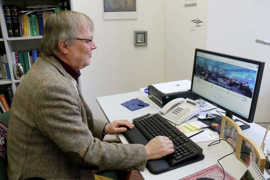 In this photo taken Wednesday, Feb. 11, 2015, Ruediger Lohlker of the Institute for Oriental Studies sits at his computer during an interview with The Associated Press on the King Abdullah Bin Abdulaziz International Center for Interreligious and Intercultural Dialogue, KAICIID, in Vienna, Austria. Austria was enthusiastic when Saudi Arabia said it was ready to bankroll a center for religious and cultural understanding in Vienna _ but two years later the desert kingdom's foray into promoting a more open society abroad while continuing to repress rights at home is in tatters. Photo: The Associated Press / AP