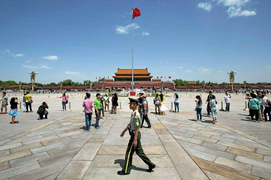 A paramilitary policeman patrols on Tiananmen Sqaure in Beijing, China, May 27. Photo: AP File Photo/Alexander F. Yuan  / AP