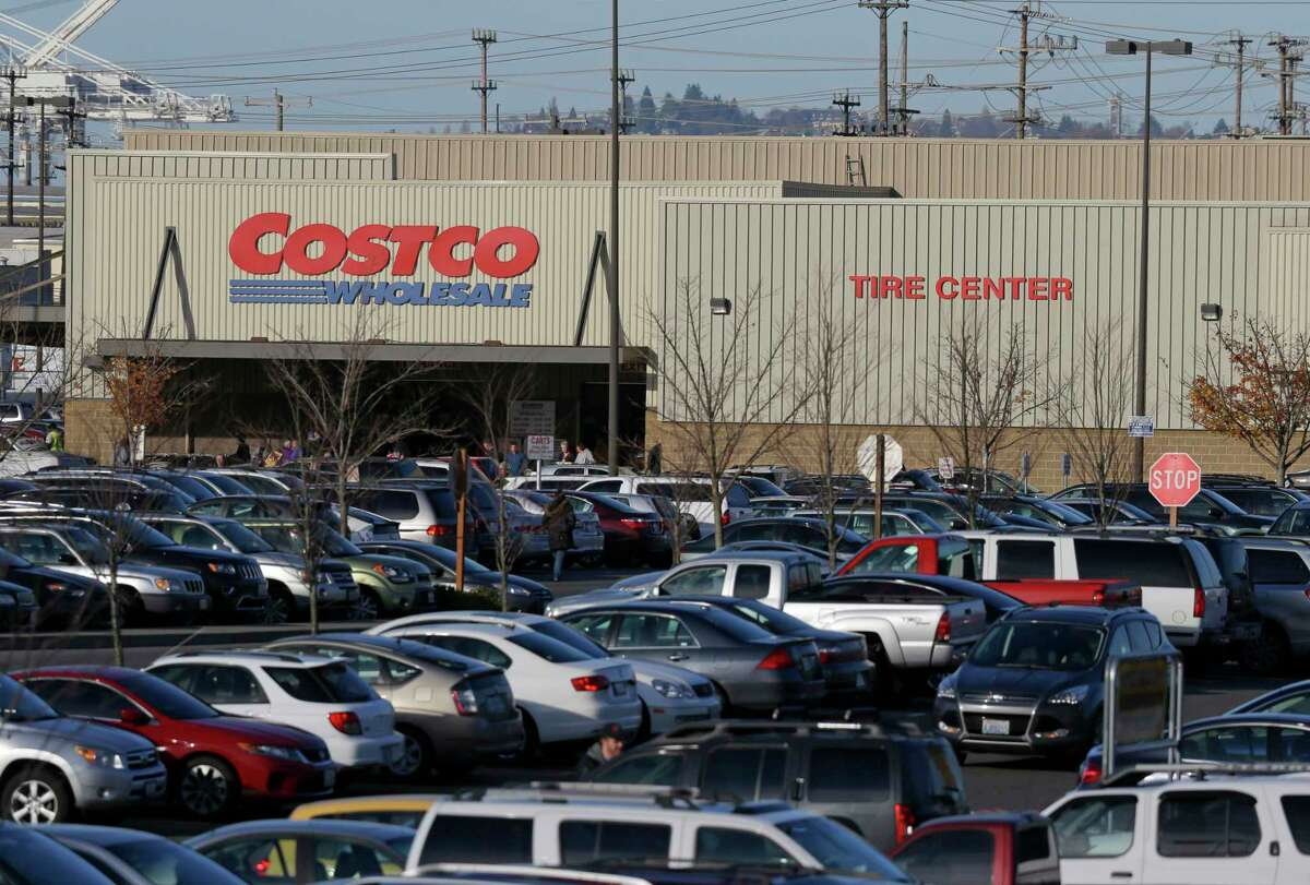 Cars fill the parking lot of a Costco store Nov. 24, 2015 in Seattle. Health authorities say chicken salad from Costco has been linked to at least one case of E. coli in Washington state.