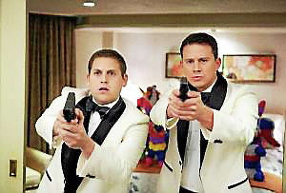 "Jonah Hill, left, and Channing Tatum star in Columbia Pictures' action comedy ""21 Jump Street."" Photo: (Courtesy Of Scott Garfield — Columbia Pictures/MCT)"