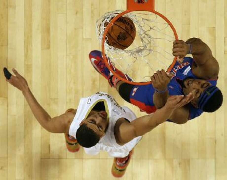 Andre Drummond of the Detroit Pistons (0) dunks the ball against Team Webber's Anthony Davis of the New Orleans Pelicans during the Rising Star NBA All Star Challenge Basketball game, Friday in New Orleans.
