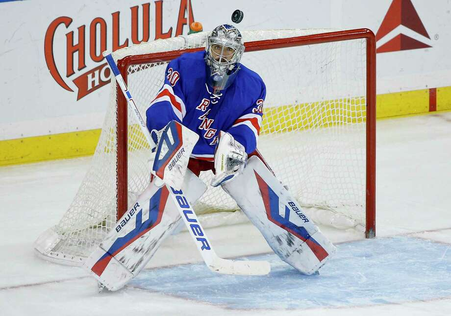 Rangers goalie Henrik Lundqvist looks for the rebound after blocking a shot against the Nashville Predators in the third period Monday night in New York. The Rangers won 3-0. Photo: Julie Jacobson — The Associated Press  / AP