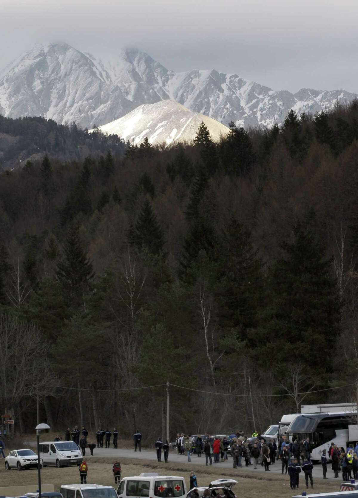 Family members of people involved in Germanwings jetliner that crashed on Tuesday in the French Alps arrive for a gathering in Le Vernet, France Thursday, March 26, 2015. The co-pilot of the Germanwings jet barricaded himself in the cockpit and ìintentionallyî rammed the plane full speed into the French Alps, ignoring the captainís frantic pounding on the cockpit door and the screams of terror from passengers, a prosecutor said Thursday. In a split second, he killed all 150 people aboard the plane. (AP Photo/Christophe Ena)