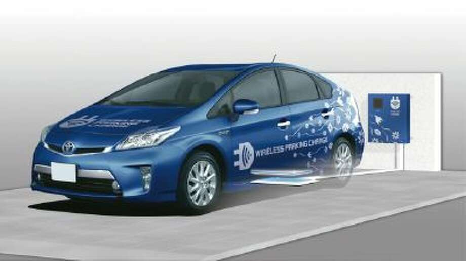 Toyota tests charging with new wireless technology.