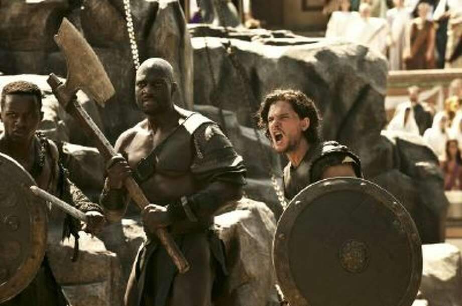 "Milo (played by Kit Harington) and Atticus (Adewele Akinnouye-Agbaje) and the Gladiators are shackled to the Obelisk in TriStar Pictures' ""Pompeii,"" to be released Feb. 21."
