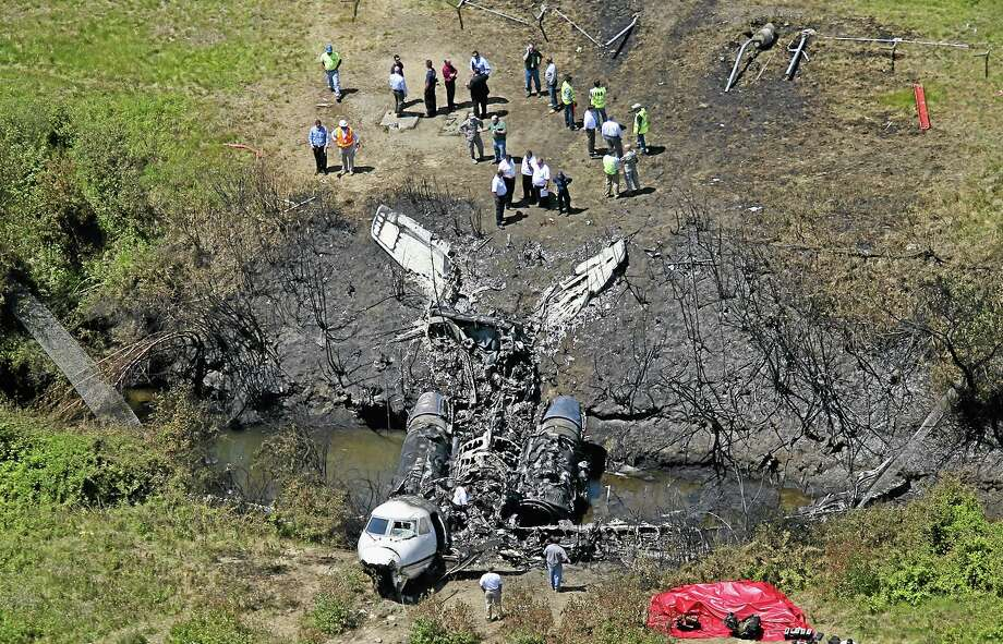 This aerial photo shows wreckage from where a plane plunged down and erupted in flames during a takeoff attempt at Hanscom Field on Saturday night, Monday, June 2, 2014, in Bedford, Mass. Lewis Katz, co-owner of The Philadelphia Inquirer, and six other people died in the crash. (AP Photo/The Boston Globe, David L. Ryan)  BOSTON HERALD OUT, QUINCY OUT; NO SALES MANDATORY CREDIT. Photo: AP / The Boston Globe