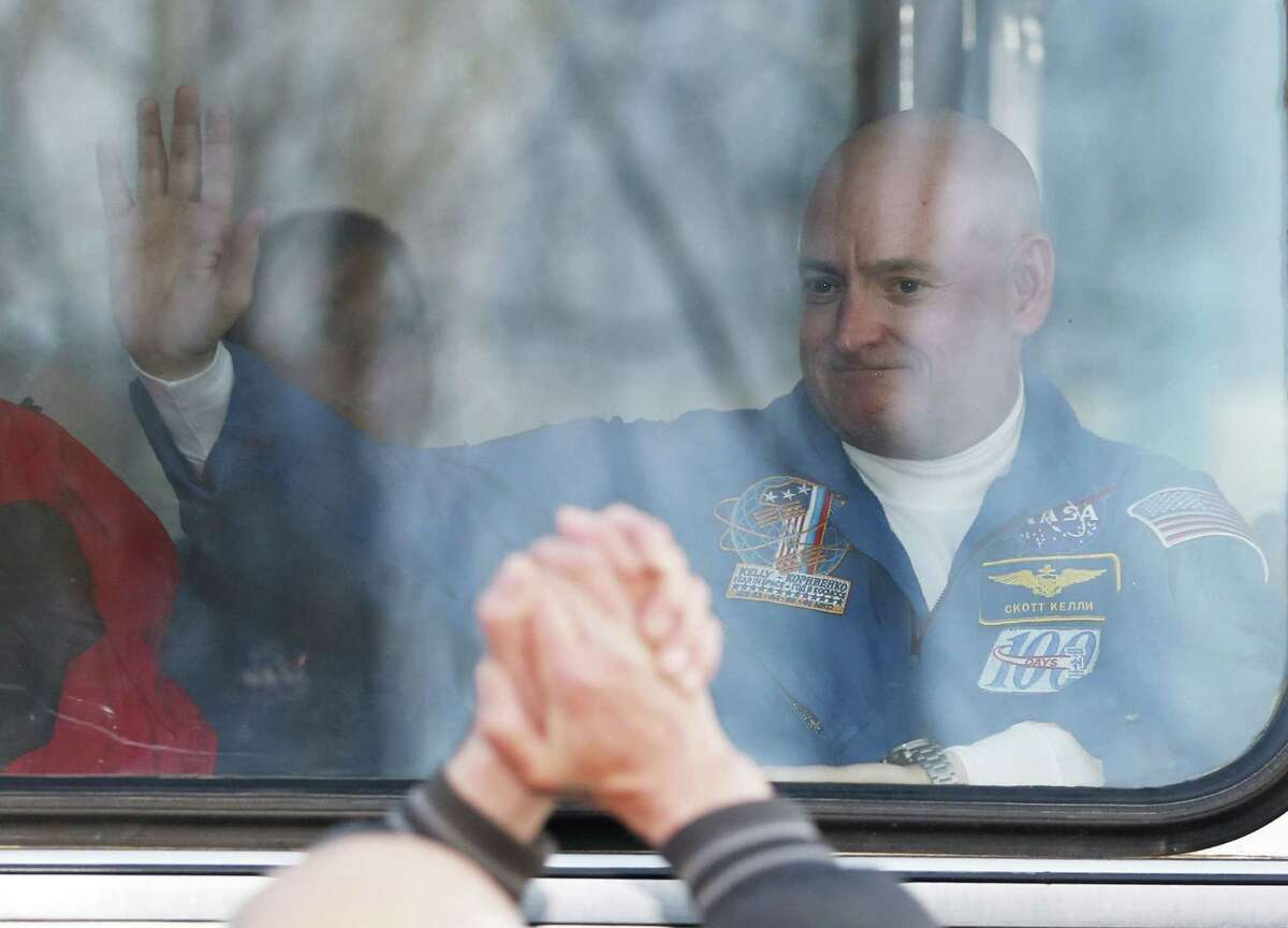 U.S. astronaut Scott Kelly crew member of the mission to the International Space Station, ISS, waves to his relatives from a bus prior the launch of Soyuz-FG rocket at the Russian leased Baikonur cosmodrome, Kazakhstan, Friday, March 27, 2015. (AP Photo/Dmitry Lovetsky)