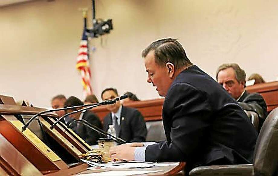 Rep. John Frey reads a statement from GE to the Finance Committee. Photo: Christine Stuart — CTNewsJunkie