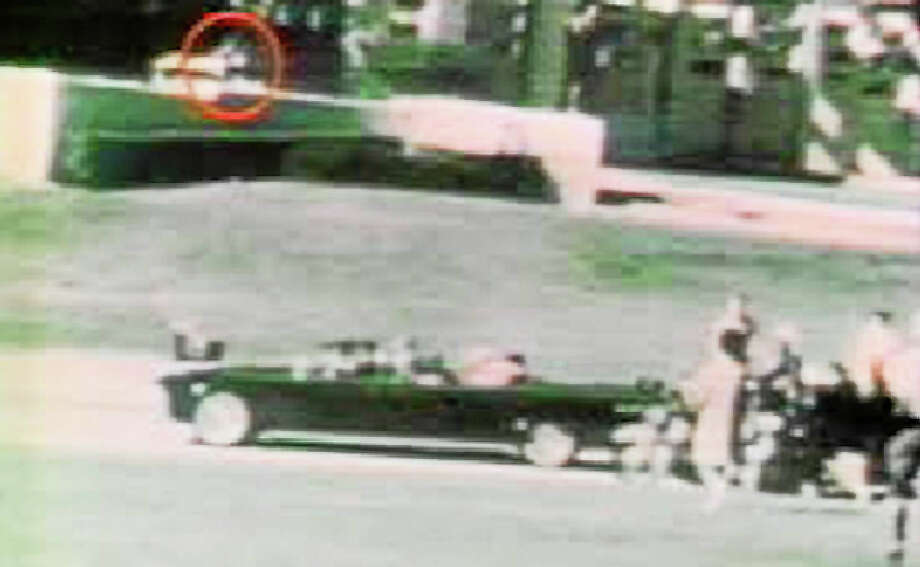 A still from Orville Nix's film showing a figure (outlined in red) who some think is a second gunman. Photo: Photo By: Court Documents — Handout  / THE WASHINGTON POST