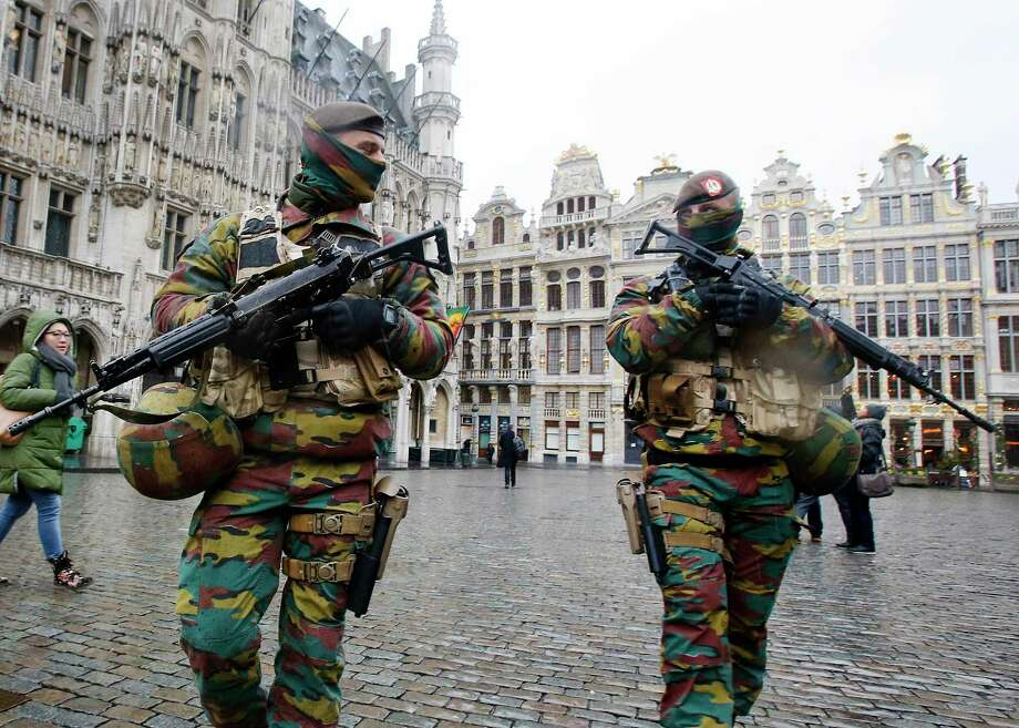 Belgium police officers patrol the Grand Place in central Brussels, Belgium on Nov. 24, 2015. The lockdown has closed the capital's subways and schools. Photo: AP Photo/Michael Probst  / AP