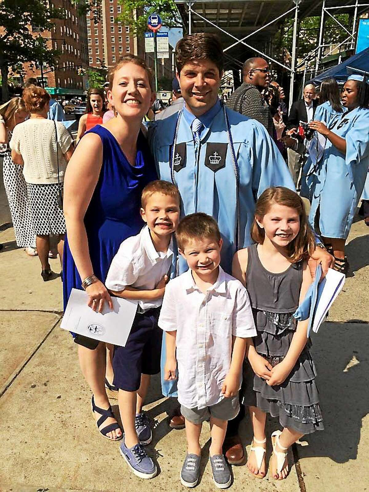 Middletown Mayor Dan Drew celebrates his advanced degree with his family at Columbia University.