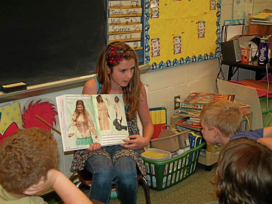"Megan Belgan reads her ""Cinderella"" story to kids at Charles F. Patton Middle School's creative writing class with Heather Spancake. Photo: Digital First Media File Photo"