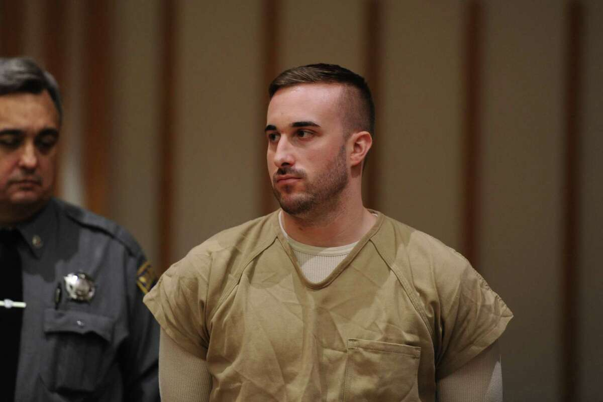 Kyle Navin, charged with killing his parents, appears at a presentment at the Fairfield County Courthouse in Bridgeport Tuesday. Jennifer Valiante, Navin's girlfriend, has pleaded not guilty to conspiracy to commit murder.
