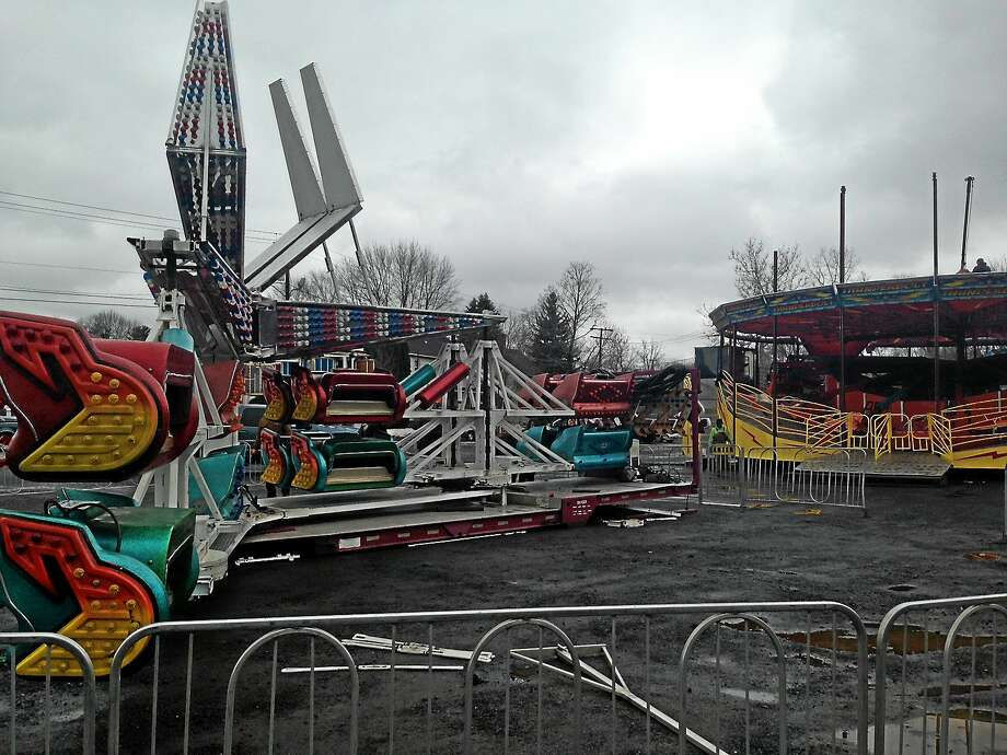 Staff for the Coleman Brothers Carnival begin setting up the rides on Friday. The carnival officially opens on Bernie O'Rourke Drive on April 2. Photo: Brian Zahn — The Middletown Press