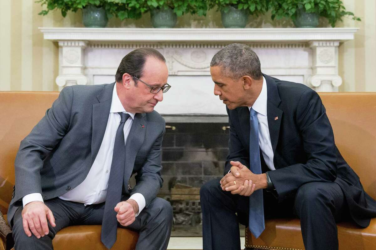 President Barack Obama meets with President Francois Hollande of France in the Oval Office of the White House in Washington Tuesday. Hollande's visit to Washington is part of a diplomatic offensive to get the international community to bolster the campaign against the Islamic State militants.