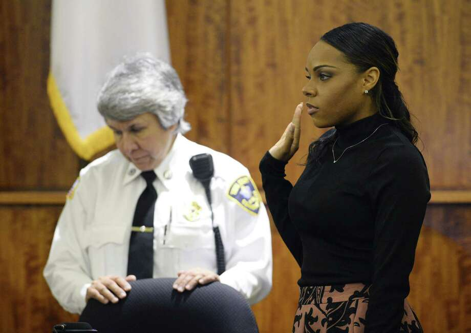Shayanna Jenkins, fiancee of former New England Patriots football player Aaron Hernandez, is sworn in before she testifies during his murder trial on Friday in Fall River, Mass. Photo: CJ Gunther — The Associated Press  / POOL EPA