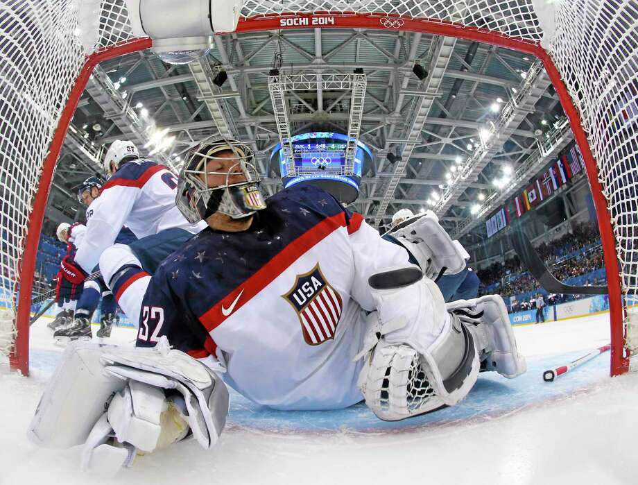 Hamden's Jonathan Quick slides into the goal while making a save against Slovakia during the second period of Team USA's 7-1 win at the Winter Olympics on Thursday in Sochi, Russia. Quick was tabbed the starter for Saturday's game against Russia. Photo: Martin Rose — The Associated Press  / Pool Getty Images