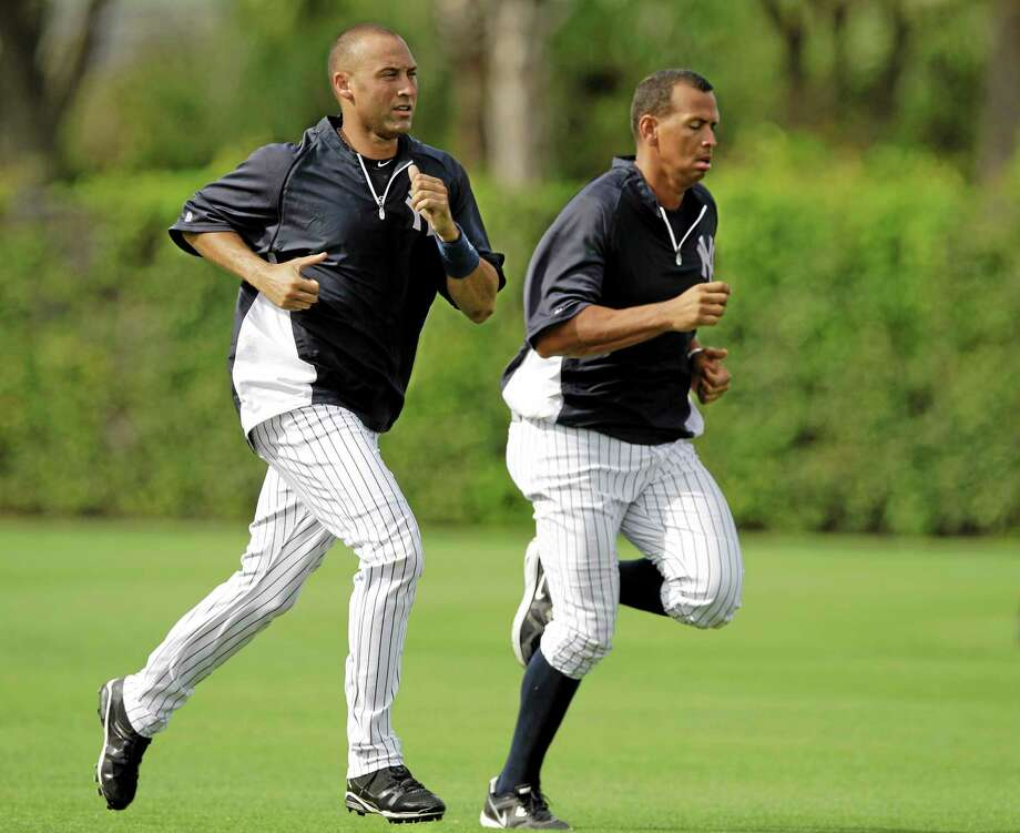 In this March 11, 2012 file photo, New York Yankees shortstop Derek Jeter and third baseman Alex Rodriguez run wind sprints before their spring training game at Steinbrenner Field in Tampa, Fla. The Yankees have kept the suspended Rodriguez's locker open. Photo: Kathy Willens — The Associated Press  / AP