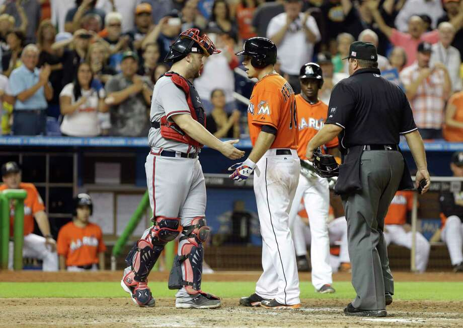 Atlanta Braves catcher Brian McCann, left, and Marlins pitcher Jose Fernandez exchange words after Fernandez hit a home run during a game Sept. 11, 2013, in Miami. Photo: Lynne Sladky — The Associated Press  / AP