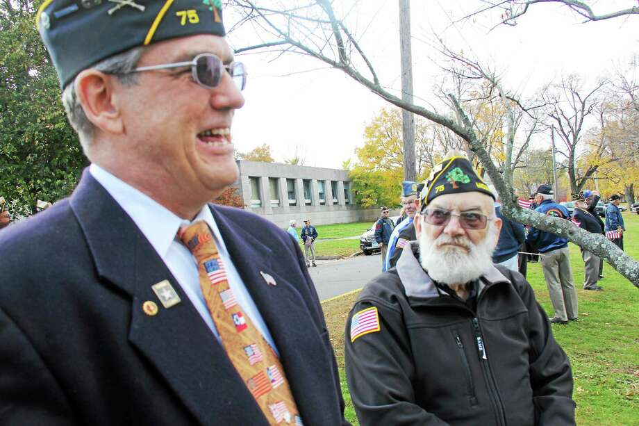 Ken McClellan, council adjutant of the Milardo Wilcox American Legion Post 75 talks with veteran Calvin Bunnel, a volunteer for the Soldiers, Sailors and Marine Fund prior to a city Veterans Day ceremony earlier this month in Middletown. Photo: Kathleen Schassler — Middletown Press   / Kathleen Schassler All Rights