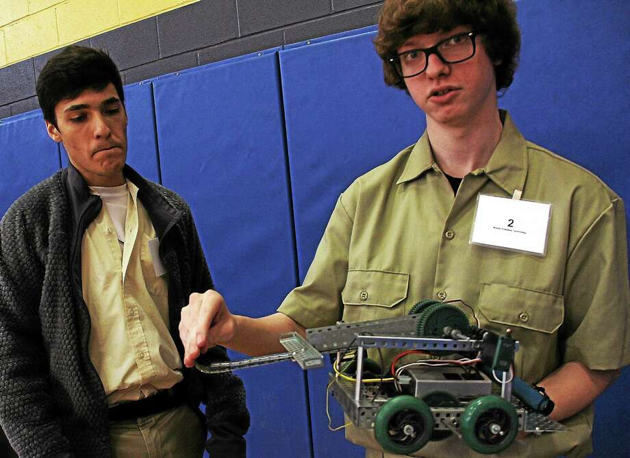 Electromechanical technology was the focus for Vinyl Technical High School students Alexander Timinskas and Adam Arias, who were competing in a robotics contest at Wilcox Tech. Photo: Kathleen Schassler — The Middletown Press  / Kathleen Schassler All Rights