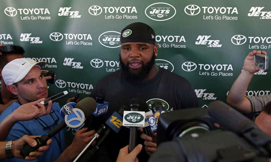 New York Jets defensive end Sheldon Richardson talks with reporters at NFL football training camp in Florham Park, N.J., Friday. Photo: Adam Hunger — The Associated Press  / FR110666 AP
