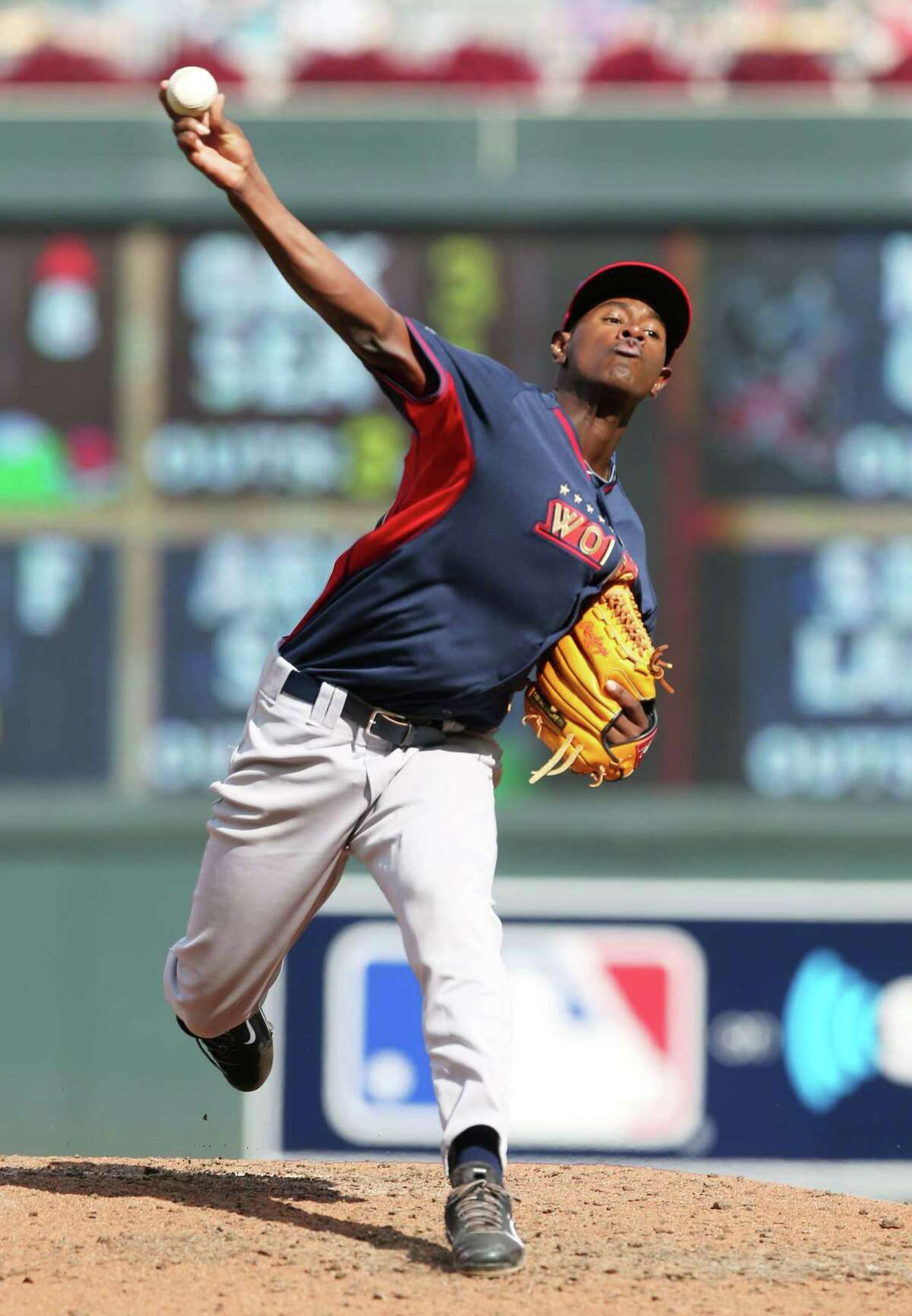 In this July 13, 2014, file photo, World's pitcher Luis Severino throws a pitch during the All-Star Futures baseball game against Team United States in Minneapolis. Touted pitching prospect Severino will make his next start with the New York Yankees. Manager Joe Girardi says the 21-year-old Severino will start at home next week against Boston, but did not specify when he would get the ball.