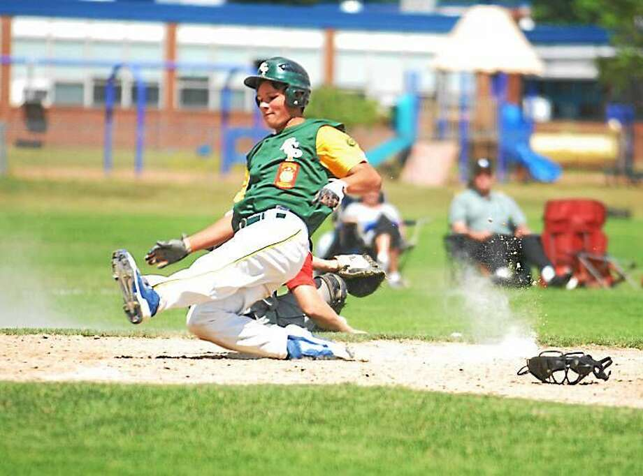 Kevin Larkin slides home with a run in RCP's 9-1 victory over West Hartford at Cromwell's Monnes Field. Photo: Jimmy Zanor — The Middletown Press