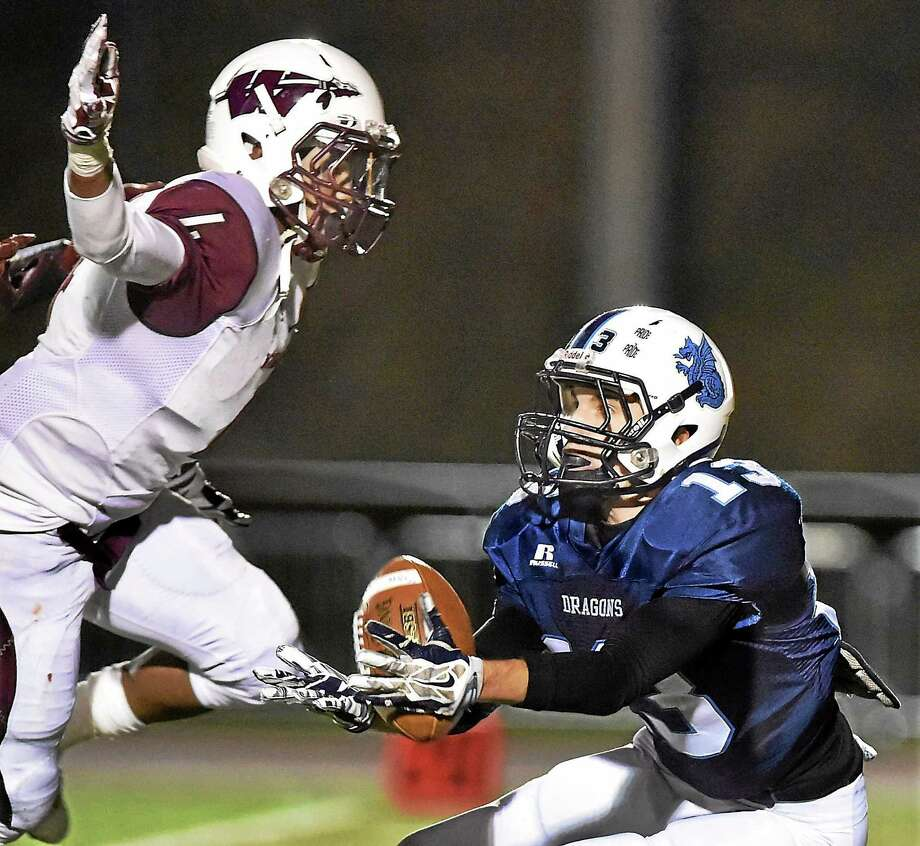 Windsor's Isaiah Huff rattles Middletown's Shawn Houle during a pass in the third quarter Tuesday night. The Windsor Warriors defeated the Middletown Blue Dragons, 46-20. Photo: Photos By Catherine Avalone — New Haven Register   / New Haven RegisterThe Middletown Press