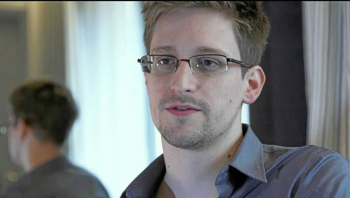 FILE - This June 9, 2013 file photo provided by The Guardian Newspaper in London shows National Security Agency leaker Edward Snowden, in Hong Kong. Snowden says his