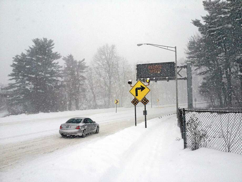 Warning signs in Middletown. Photo: Alex Gecan - The Middletown Press