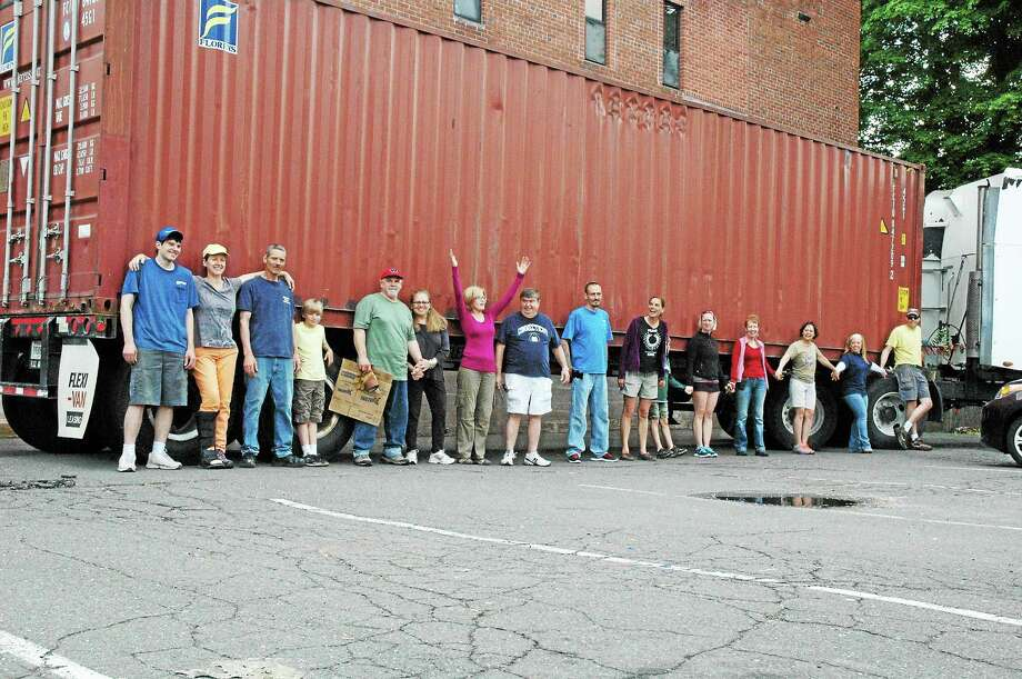 Chris Nolet - Special to the Press Volunteers joined Middletown artist Wendy Black-Nasta, founder of Artists for World Peace, and her husband, musician Robert Nasta to pack a 40-foot container with bicycles and hospital equipment. Photo: Journal Register Co.