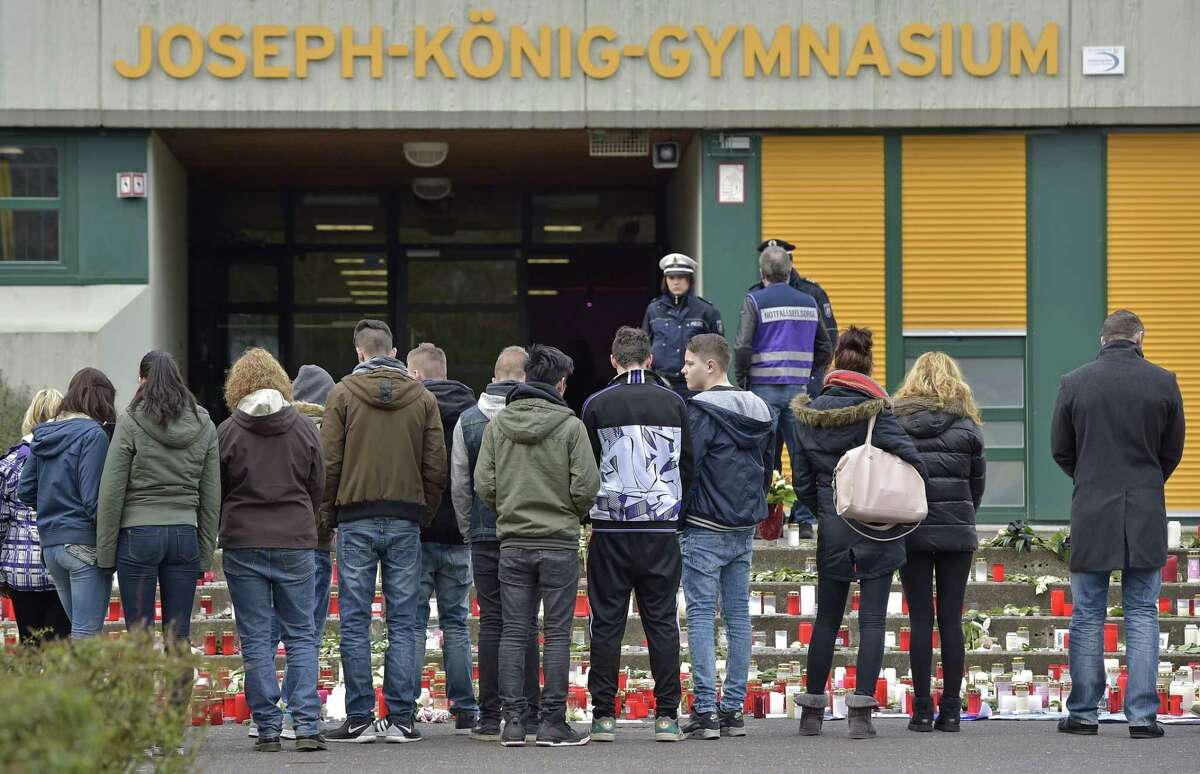 Pupils mourn in front of flowers and candles, placed at the Joseph-Koenig Gymnasium in Haltern, Germany, on March 26, 2015.