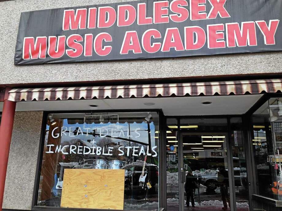 The Middlesex Music Academy at 440 Main St. was broken into Thursday night after someone shattered the window and stole two guitars. Photo: Kaitlyn Schroyer — The Middletown Press