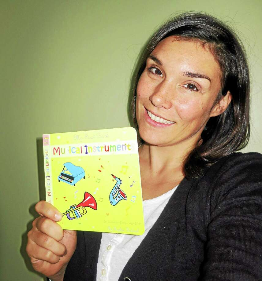 "Haddam resident and author Sophie Helenek recently released four early-child development books under the ""My First Book"" series. The books help parents interact with their newborn babies through visual and speech stimulation. Photo: Submitted Photo"