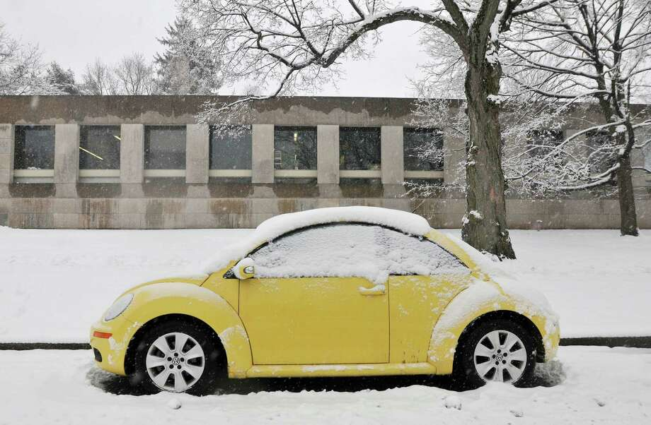 Catherine Avalone - The Middletown Press A parking ban is in effect in Middletown starting Tuesday at midnight until the City of Middletown announces all city streets are clear Wednesday. Photo: Journal Register Co. / TheMiddletownPress