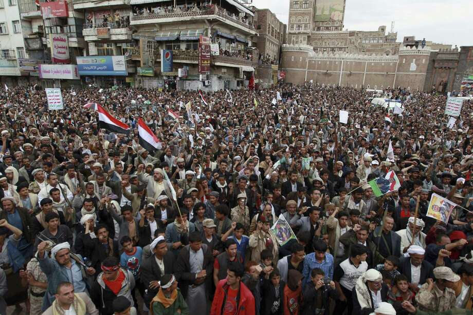Shiite rebels, known as Houthis, gather to protest against Saudi-led airstrikes, during a rally in Sanaa, Yemen, Thursday. Saudi Arabia bombed key military installations in Yemen, and Yemen's fleeing president has taken refuge in Saudi Arabia. Photo:   (AP Photo/Hani Mohammed) / AP