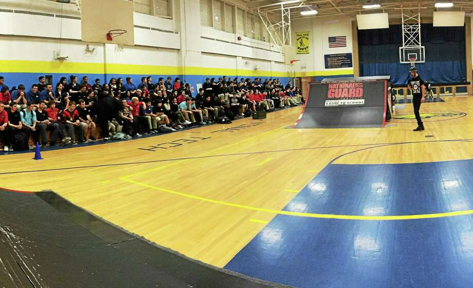 Vinal Technical High School 11th-graders showed no hesitation when Army National Guard BMX athletes put on the Bring your A Game show last week, asking for volunteers willing to lie on the floor as a rider caught some air, soaring over them. Here, Andrew Fox shows off his moves. Photo: Courtesy Photo
