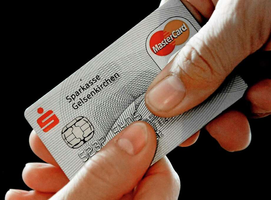 FILE - In this Nov. 18, 2009 file photo, a Mastercard chip-based credit card is posed for a photo in Gelsenkirchen, Germany. In the wake of recent high-profile data breaches, including this weekís revelation that hackers stole consumer data from eBayís computer systems, Visa and MasterCard are renewing a push to speed the adoption of microchips into U.S. credit and debit cards. (AP Photo/Martin Meissner, File) Photo: AP / AP