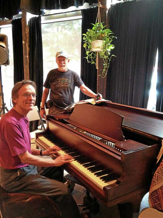 Buttonwood volunteers Bruce MacLeod and Charles Hubert test the center's recently donated Steinway piano. Photo: Courtesy Buttonwood Tree